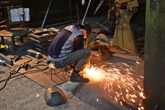 Worker grinding steel Royalty Free Stock Photos
