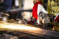 Worker grinding steel stock image