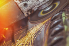 Worker grinding steel pipe with grinder Royalty Free Stock Photo