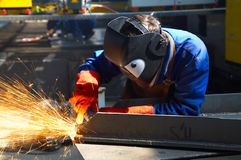 Worker grinding/welding Stock Photography