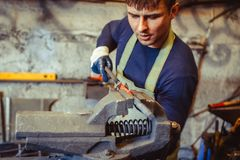 The worker grips the vice royalty free stock photography