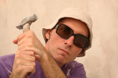 Worker with hammer Stock Image