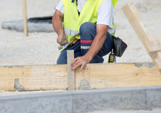 Worker with hammer Stock Photos