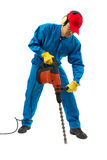 Worker with a hammer drill. Worker with hammer equipment on a white background Stock Image