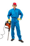 Worker with a hammer drill. Worker with protective gear holding a hammer drill on a white background Stock Photos