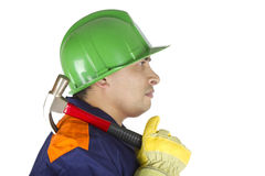 Worker with a hammer on his shoulder Stock Images