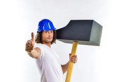 Worker with a hammer thumb up Stock Photo