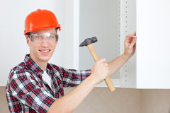 Worker with a hammer Royalty Free Stock Images