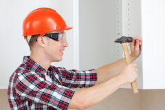 Worker with a hammer Royalty Free Stock Photo
