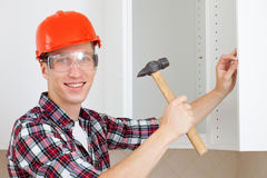 Worker with a hammer Stock Photo