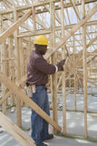 Worker Hammering On House Frame Royalty Free Stock Photo