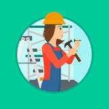 Worker hammering nail. Stock Photo