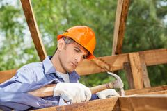 Worker Hammering Nail On Wooden Cabin Stock Images