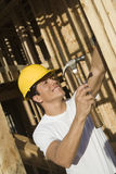 Worker Hammering Nail On Wooden Wall Stock Photography