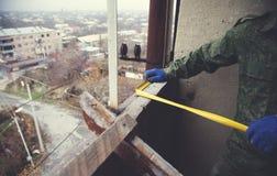Worker hand centimeter stock photos
