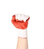 Worker hand glove clenching fist. Stock Photo