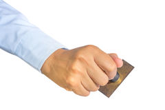 Worker hand holding old rubber stamp Royalty Free Stock Photos