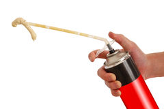 Worker hand holding polyurethane expanding foam glue gun applica Royalty Free Stock Images