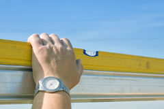 Worker hand while measuring with spirit level Stock Photo