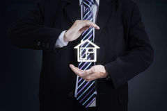 Worker hand protecting house symbol Royalty Free Stock Photo