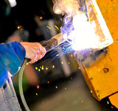 A worker hand. The hand of a worker using fire to bond two pieces of metal for a train Royalty Free Stock Image