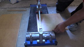 Worker hand using tile cutter at home renovation work stock video footage