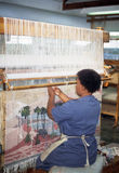 Worker hand weaving a wool carpet Royalty Free Stock Images