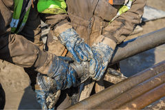 Worker hands checks a diamond core drill bit Royalty Free Stock Images