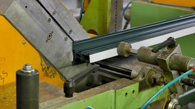Worker hands cut aluminum profile with circular saw on machine in factory. stock footage