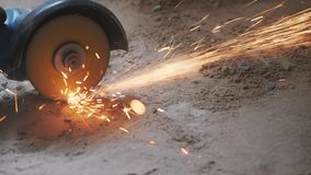 Worker hands cutting metal tube with circular saw with orange sparks. Construction concept. Metal cut by worker circular hand saw. Slow motion stock footage