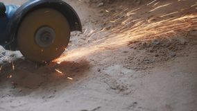 Worker hands cutting metal tube with circular saw with orange sparks. Construction concept. Metal cut by worker circular hand saw. Worker hands cutting metal stock video footage