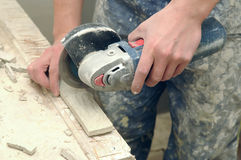 Worker hands cutting a tile Royalty Free Stock Photos