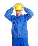 Worker with hands on his hardhat Stock Images
