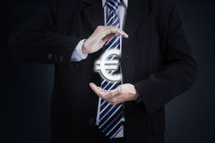 Worker hands hold Euro currency sign Stock Image