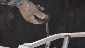 Worker hands turning lever on piece of metal industrial machinery in ditch stock video footage