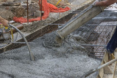 Worker hands using concrete vibrator 2 Royalty Free Stock Photos