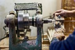 Worker hands using woodturning lathe tool and industry tools Stock Photos