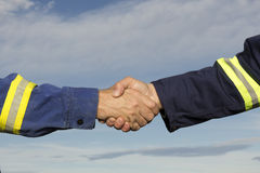 Worker Handshake. Two construction workers shaking hands Royalty Free Stock Photo