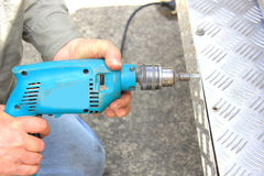 Worker using electric drill Royalty Free Stock Photography