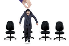 Worker hanging on a hand above chairs Royalty Free Stock Images