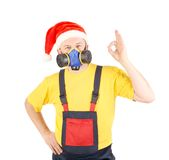 Worker in har with respirator. Royalty Free Stock Photography