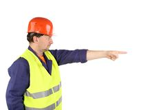 Worker in hard hat with hand up Stock Image
