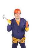 Worker in hard hat holding hammer Royalty Free Stock Photo