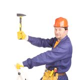 Worker in hard hat holding hammer. Royalty Free Stock Photo