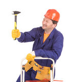 Worker in hard hat holding hammer. Stock Photography