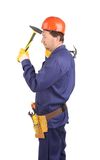 Worker in hard hat holding hammers Royalty Free Stock Image