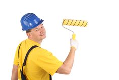 Worker in hard hat holding roller Royalty Free Stock Images