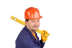 Worker in hard hat holding ruler Stock Images