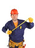 Worker in hard hat holding ruler Royalty Free Stock Photography