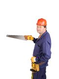 Worker in hard hat holding saw Royalty Free Stock Images